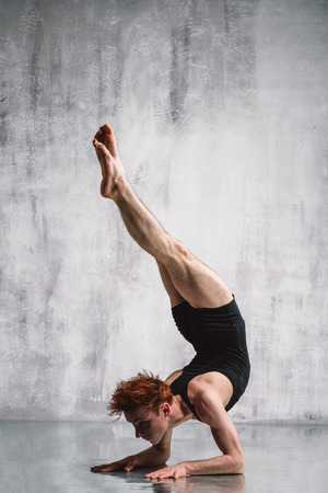 young dancer: young beautiful modern style dancer posing on a studio background