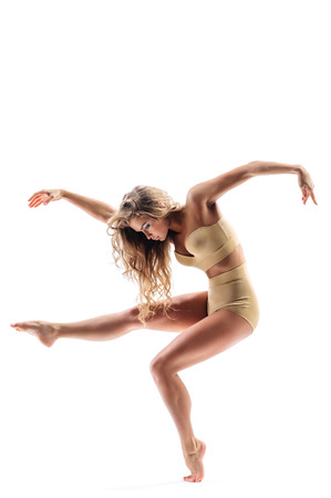 contemporary style: young beautiful dancer posing in studio