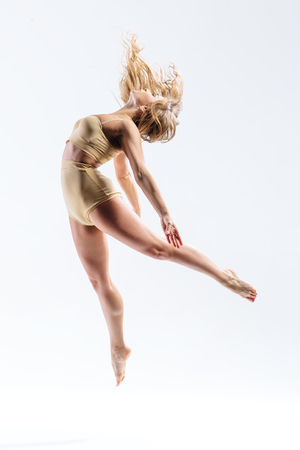 dancers: young beautiful modern style dancer posing on a studio background