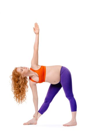 yogic: Beautiful pregnant woman in yogic pose Stock Photo