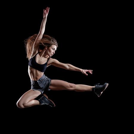 young dancer: Young beautiful dancer jumping in studio