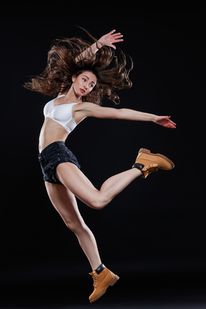 young dancer: Young beautiful dancer posing in studio