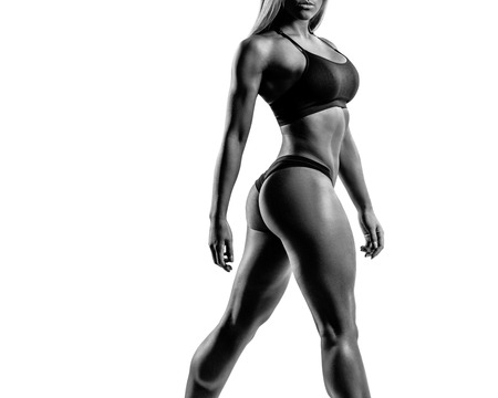 fitness motivation: young sporty female in black and white