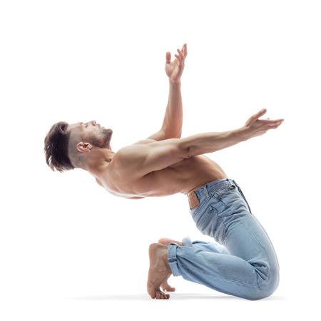 desnudo masculino: young and beautiful modern style dancer posing