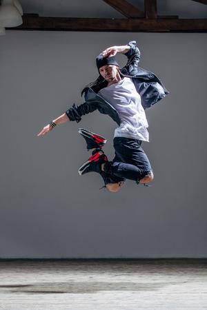 rapping: Young beautiful dancer posing in studio