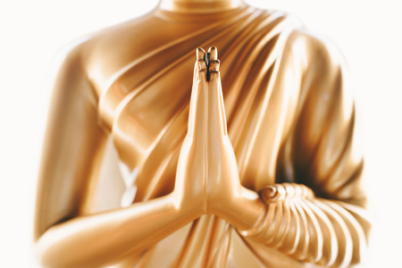 Close up of the hands of statue Buddha