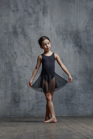 Ballerina girl posing in dance studio