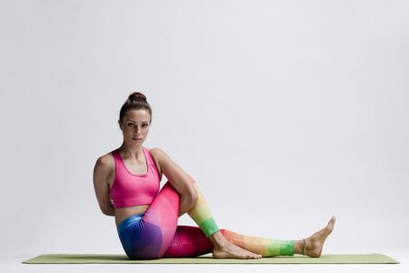 Young beautiful yoga female posing in studio