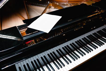 Piano keyboard with glossy black and white keys Reklamní fotografie - 95986851