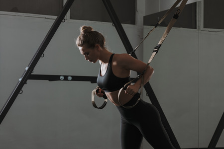 Sporty woman doing  exercises in the gym