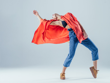 Young beautiful female dancer is posing in the studio Stock Photo