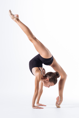 Young gymnast girl stretching and training Banco de Imagens - 96903869