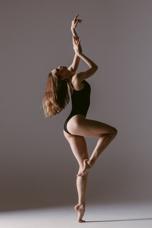 Young gymnast woman stretching and training