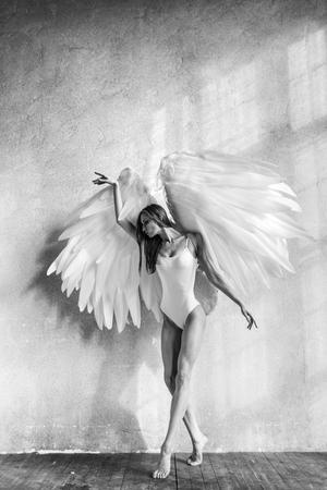 angel woman posing in studio