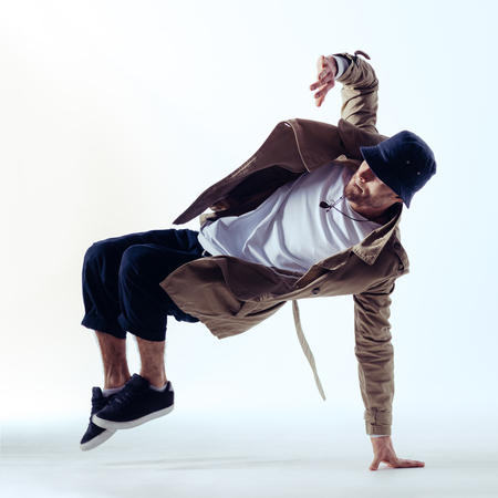 Young beautiful male dancer posing in studio