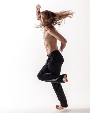 Young beautiful dancer posing in the studio