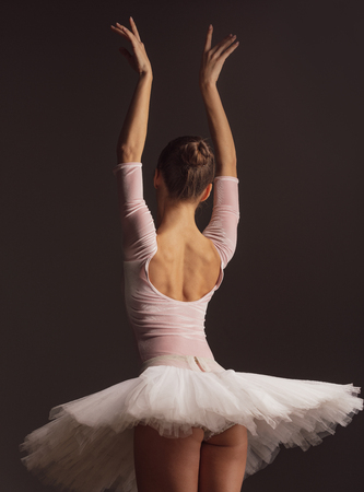 Young beautiful ballerina is posing in studio 写真素材 - 104536007