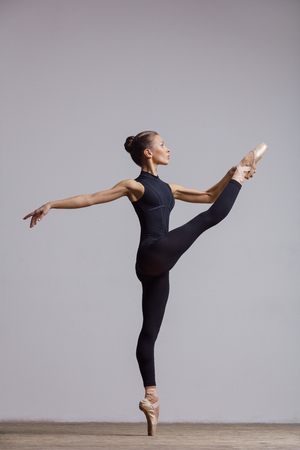 Young beautiful ballerina is posing in studio Stock Photo - 104536049