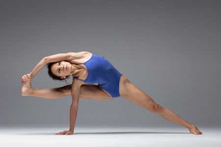 Young beautiful yoga woman is posing in studio Stok Fotoğraf