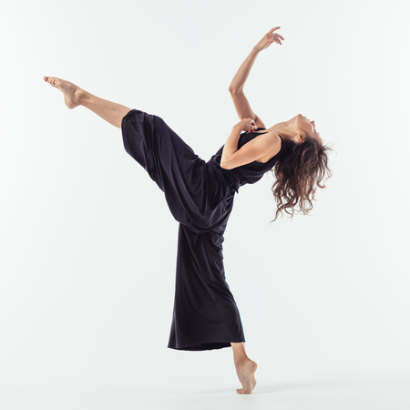 Beuatiful female dancer. Studio background.