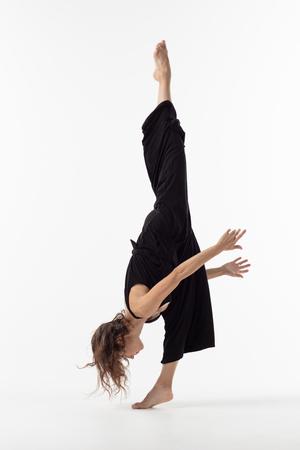 Beuatiful female dancer. Studio background.