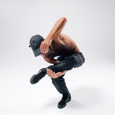 Hip hop dancer moving and jumping in photostudio Stock Photo