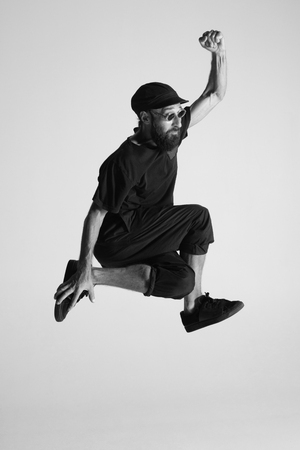Hip hop dancer moving and jumping in photostudio Stock fotó