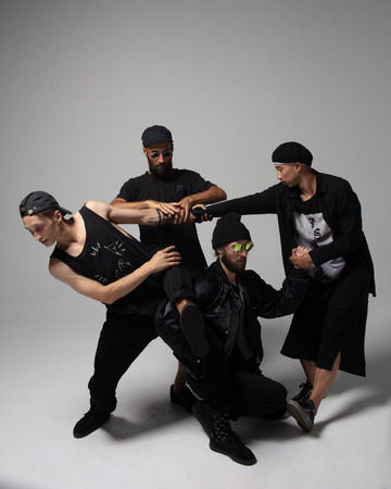 Hip hop dancers moving and jumping in photostudio