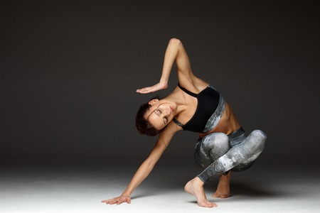 Beautiful female yoga teacher