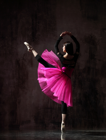 one ballerina dancing in pink tutu