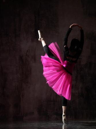 one ballerina dancing in pink tutu
