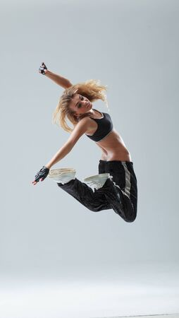 modern style dancer jumping on studio background Stok Fotoğraf