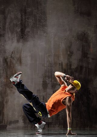 cool looking dancer posing on a grunge background