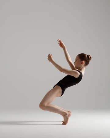 Young gymnast girl stretching and training Archivio Fotografico