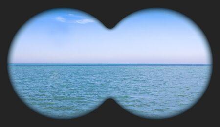 Sea view through binoculars. Seascape view via the field-glass.