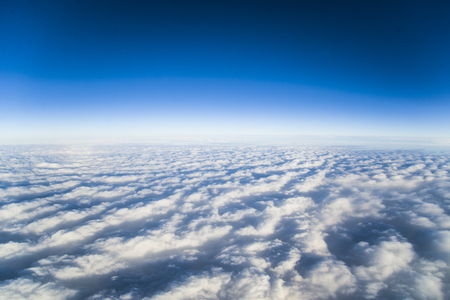 vertices: Clouds in the sky. The view from the airplane window. It looks like the cloud is a vast white ocean.