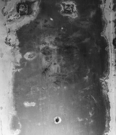 Terrible, terrible, frightening face on a dirty ceiling
