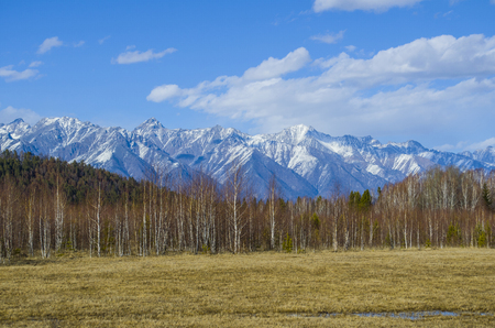 The beautiful mountain landscape. In the distance are seen the high and mighty Sayan mountains. Stock Photo