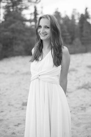 black and white photograph: Beautiful girl walking on the beach. Black-and-white photograph.