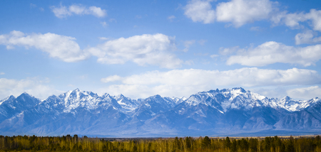 The photo shows the endless expanses of the Siberian mountains. Eastern Sayan Mountains.