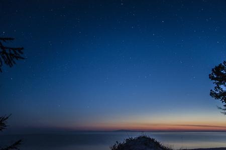 Bright stars shining over the great lake Baikal.