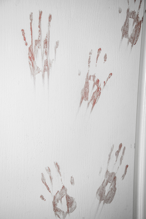 The door is stained with traces of bloody hands. Zombie Apocalypse. Banco de Imagens