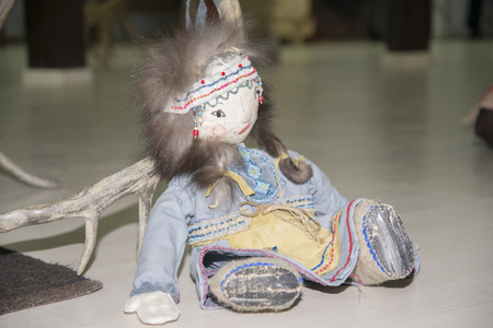 Yakut handmade doll sits on the floor. The object of folk art. Stock Photo