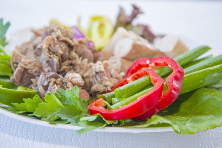 Cooked entrails of sheep (intestines, stomach) with vegetables. Stock Photo
