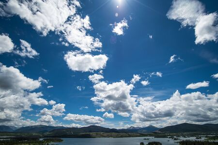 lake dillon: Blue Sky and clouds over mountain lake Lake Dillon, Colorado Stock Photo