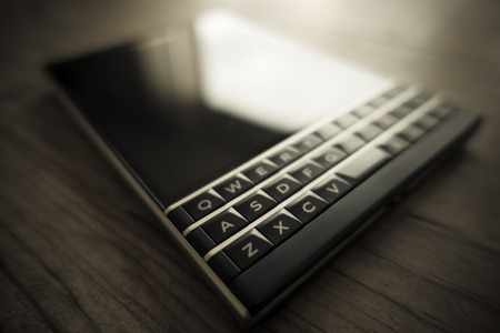 qwerty: Black Smartphone with physical QWERTY keyboard Stock Photo