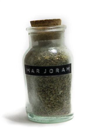 spice: Marjoram in a glass spice jar with cork top