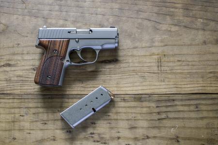 amendment: Stainless Steel 9mm Pistol
