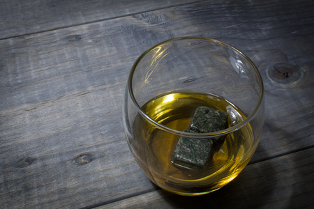 intoxicant: Whiskey with whisky rocks on a wooden table