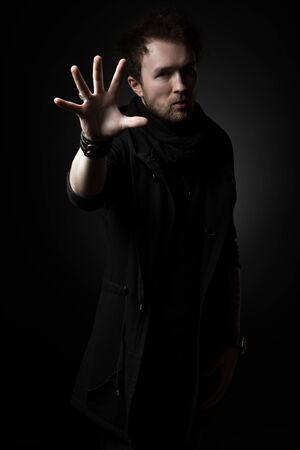 Male illusionist on a black background